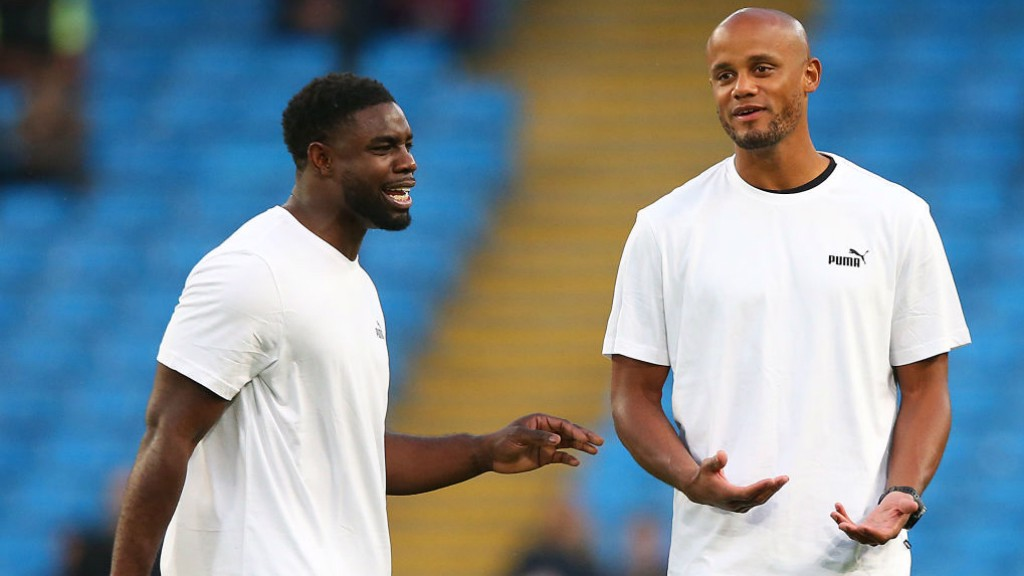 OLD FRIENDS: Newly-retired Micah Richards warms up with Vincent Kompany before his Testimonial kicks off
