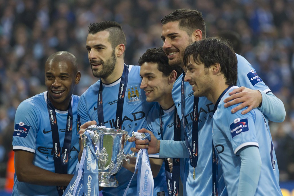 GROUP SHOT: Fernandinho poses with the League Cup in 2014