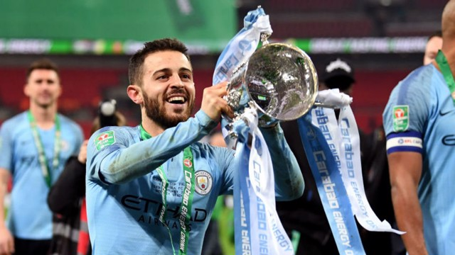 SILVA DREAM MACHINE: Bernardo lifts the Carabao Cup aloft again after our dramatic penalty shoot-out win over Chelsea last month