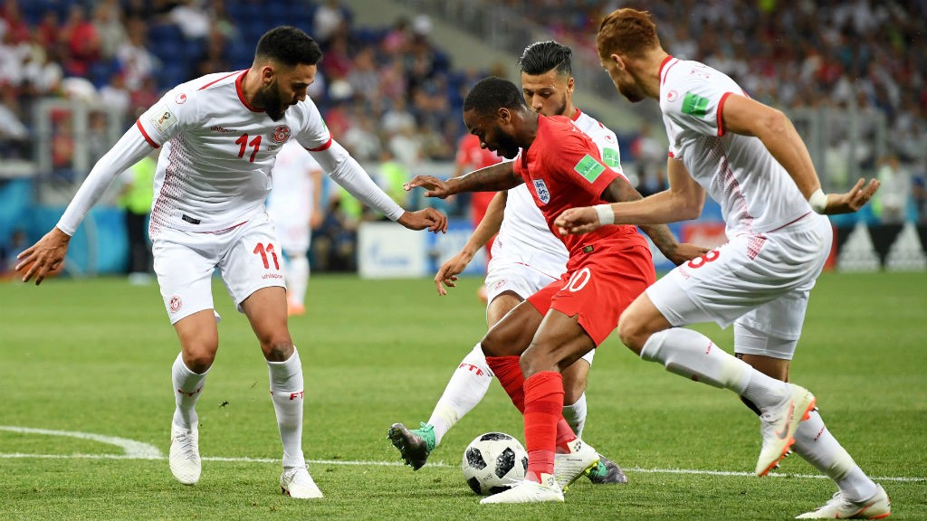 ON THE BALL: Raheem Sterling attracts the attention of three Tunisia defenders