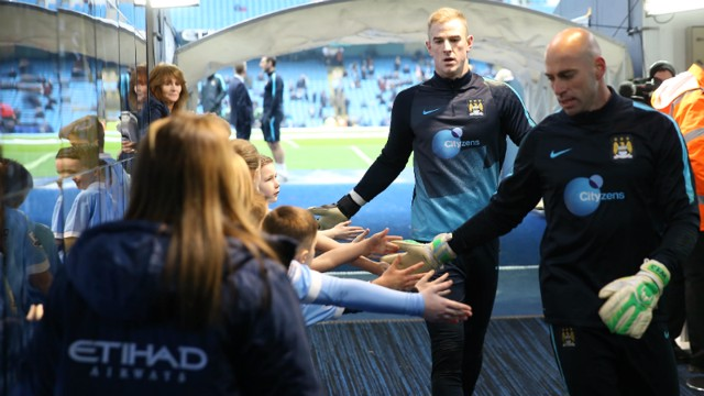 Willy Caballero and Joe Hart greet mascots in the tunnel