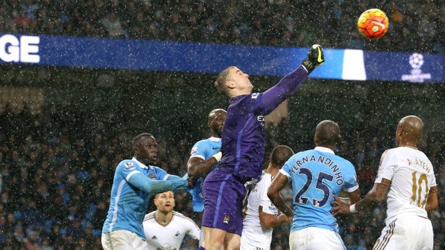 Hart punches ball clear
