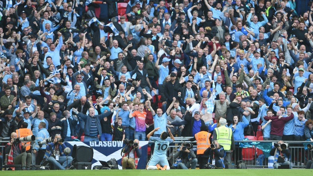 CELEBRATATIONS: City supporters celebrate Aguero's goal to break the deadlock.