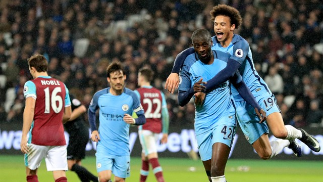 AWWYEAH: Yaya Toure is mobbed by Leroy Sane, and flashes a cheeky smile to the City fans!