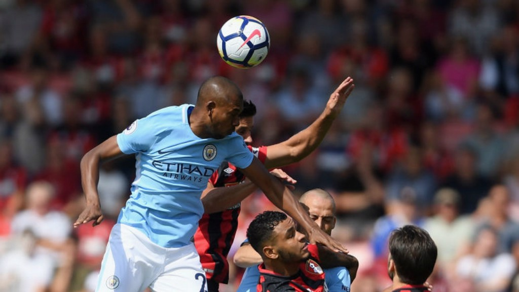 EARLY BATTLE: Fernandinho competes with Harry Arter for the header