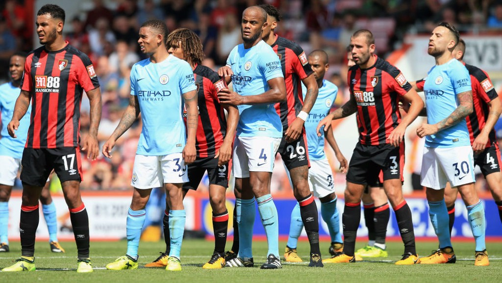 HOLD THE LINE: Kompany dishes the orders as City deal with a Bournemouth set-piece