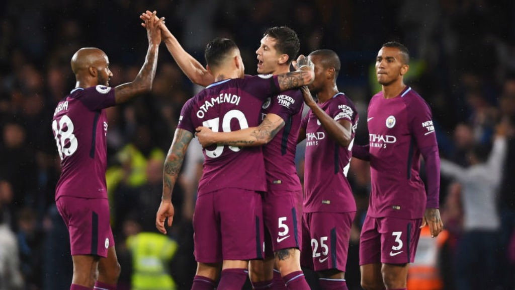 JOB DONE: The City players celebrate after a huge victory