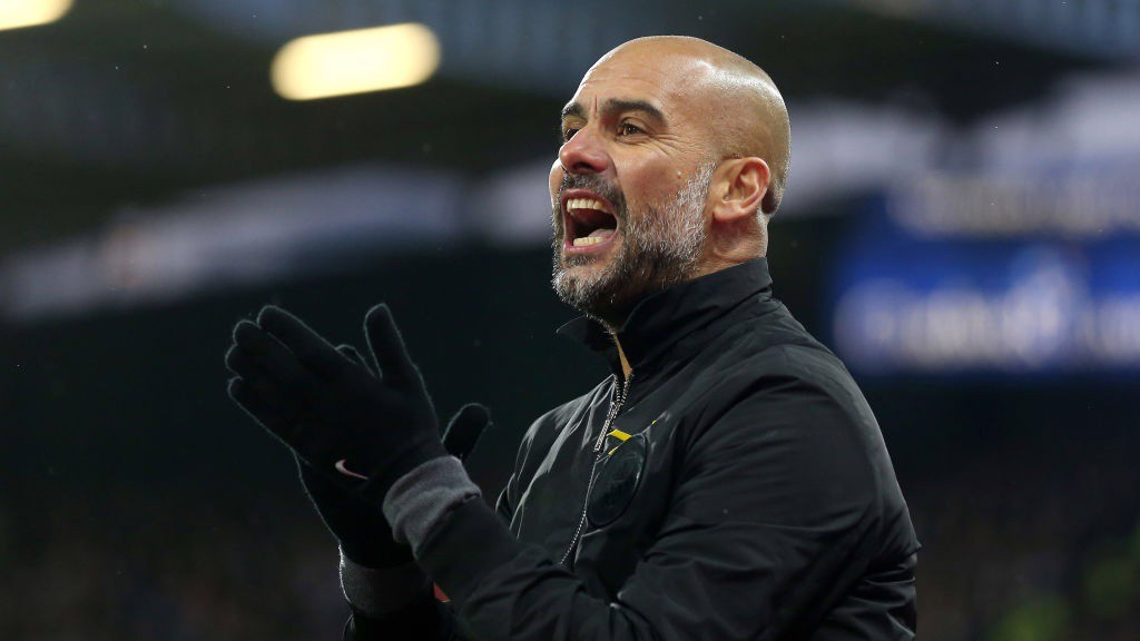COME ON LADS: Pep urges his side on from the touchline.