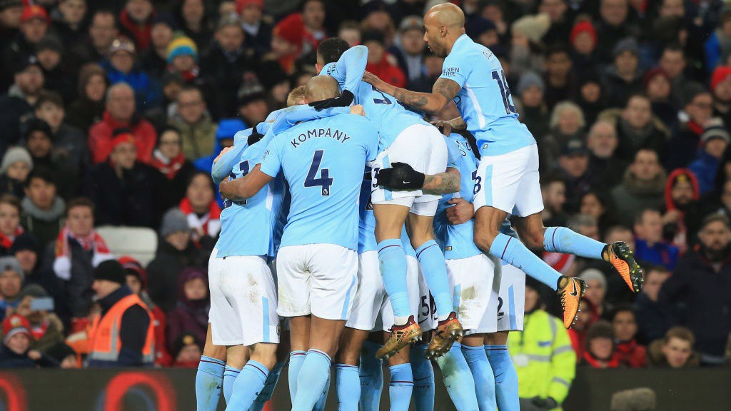 BREAKTHROUGH: City pile on David Silva after his volley opened the scoring.
