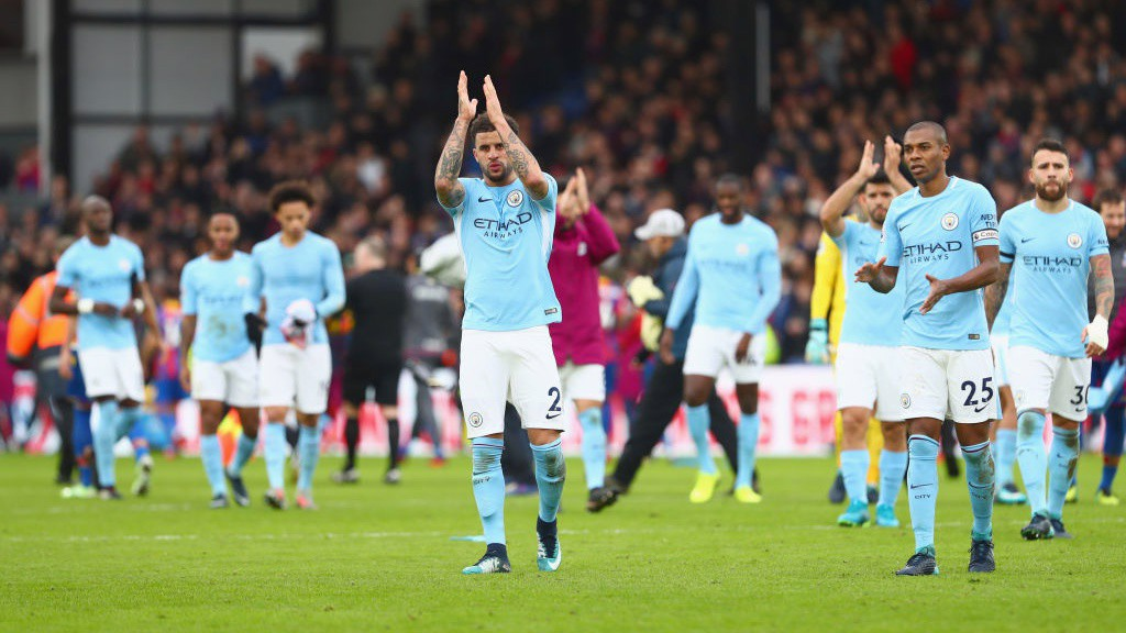 UNBEATEN: Kyle Walker is at the forefront as City salute a fantastic away support.