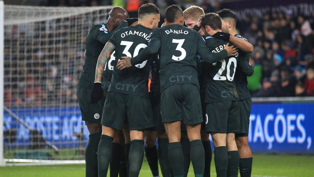 UNITY: City celebrate going 2-0 up.
