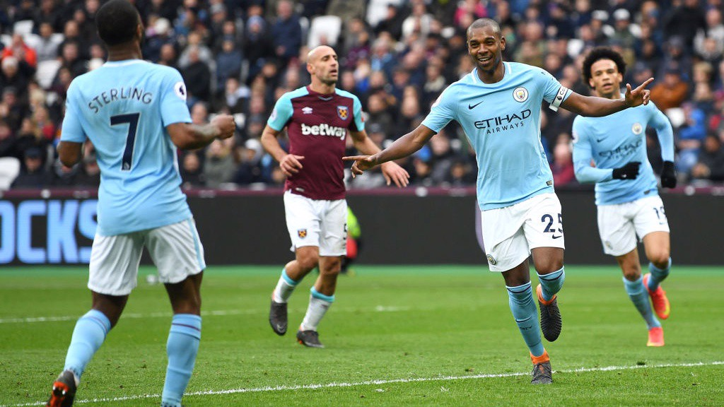 LEADER: Fernandinho celebrates after firing home City's fourth goal.