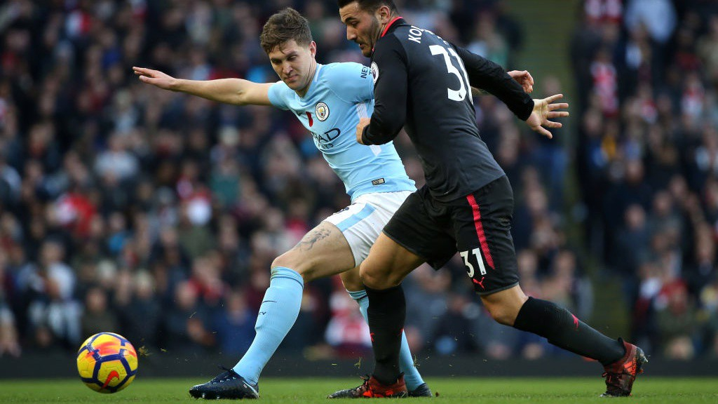 SOLID AT THE BACK: John Stones vies for possession with Arsenal's Sea Kolasinac.