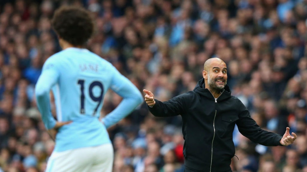 PEP TALK: Pep Guardiola gets his point across to Leroy Sane