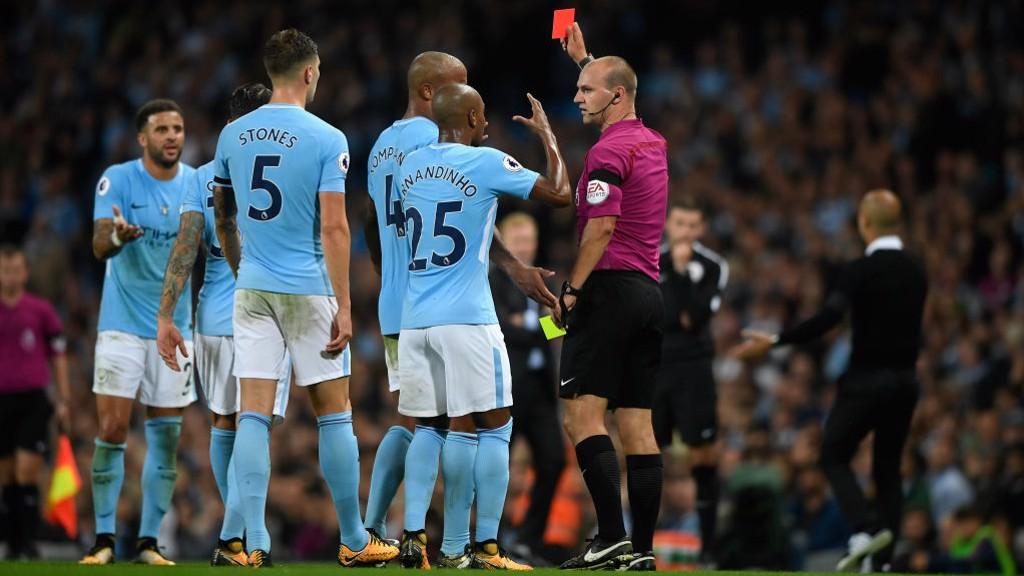TALKING POINT: Walker is shown a debatable second yellow on the stroke of half-time.