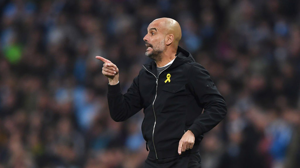 WATCHFUL: Pep Guardiola surveys the situation