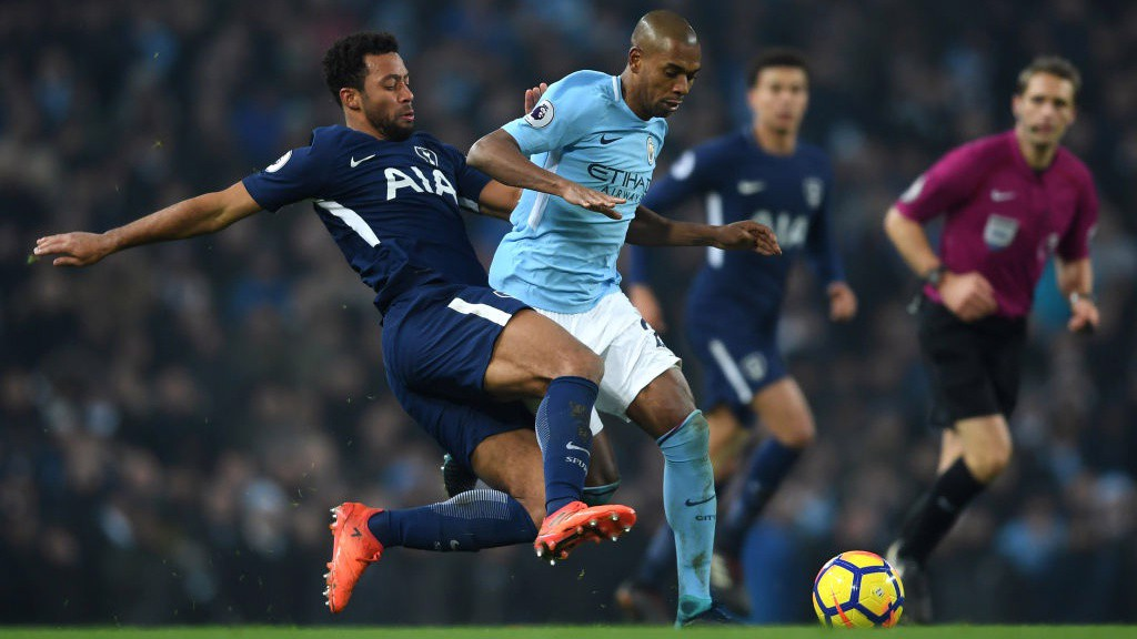 BATTLING: Fernandinho is harried by Tottenham's Mousa Dembélé.