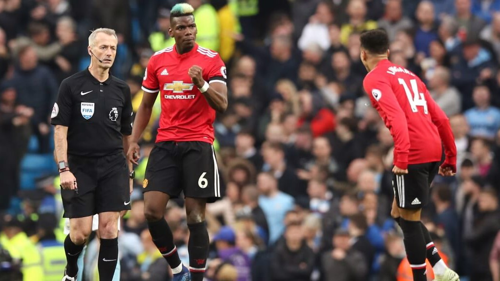 BACK IN IT: Paul Pogba gets one back for United.