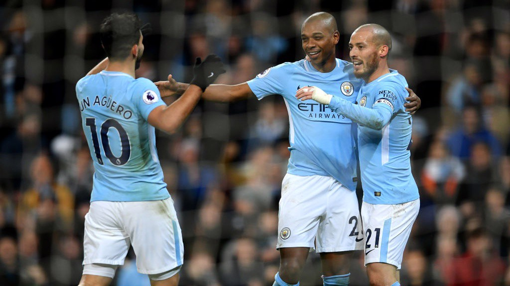MIDFIELD MAESTRO: City celebrate Fernandinho's cooly-taken finish.