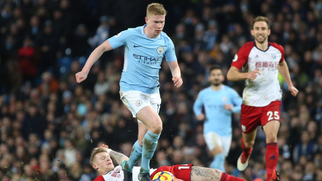 SHOCKER: Kevin De Bruyne survives a horror tackle from West Brom's James McClean.