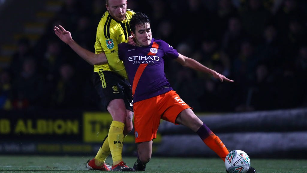 CLEARING THE DANGER: Eric Garcia stops a Burton attack with a timely interception