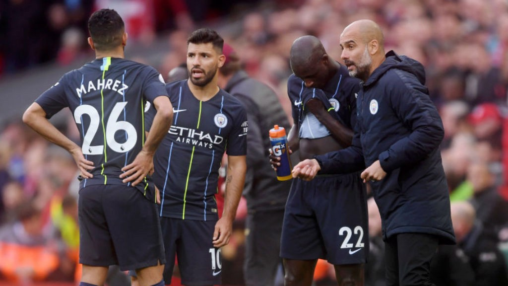 TALKING POINT: Pep Guardiola passes on instructions to the City players