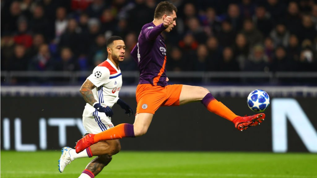 AT FULL STRETCH: Aymeric Laporte clears from Memphis Depay