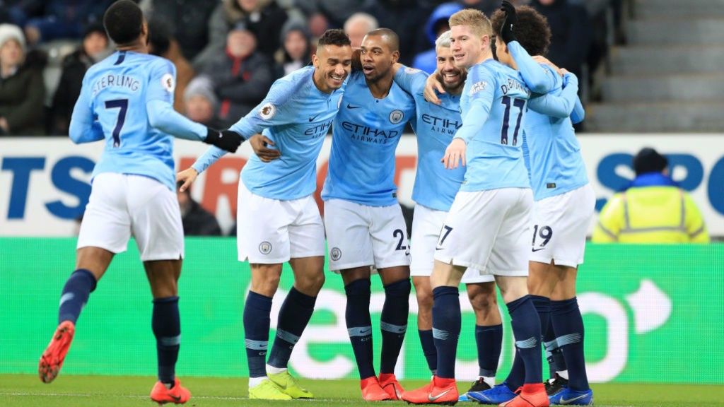 CELEBRATION: Aguero is congratulated by his teammates after giving City the lead