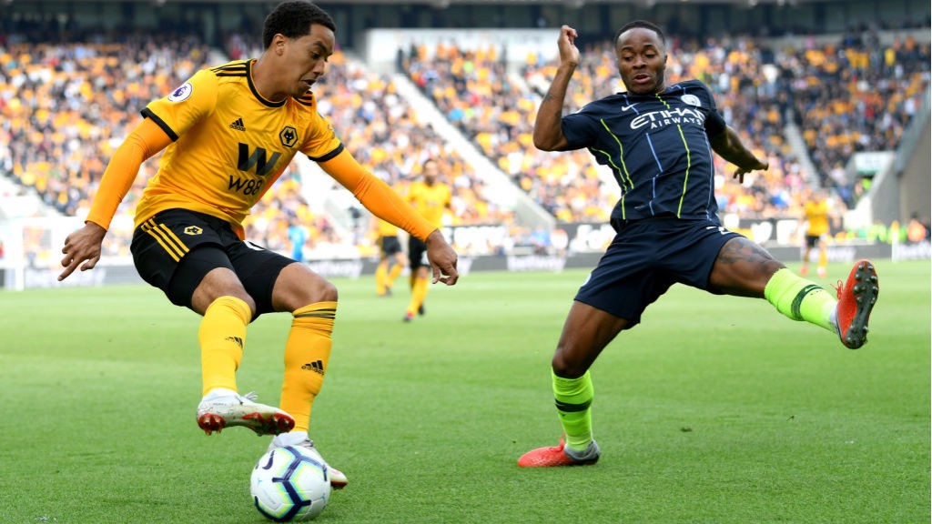 STOP START: Raheem Sterling is at full stretch at he looks to stop Helder Costa