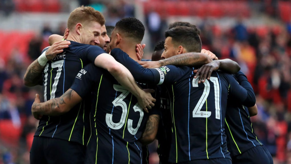 CELEBRATION TIME: Gabriel Jesus is joined by his happy team-mates after his opening goal