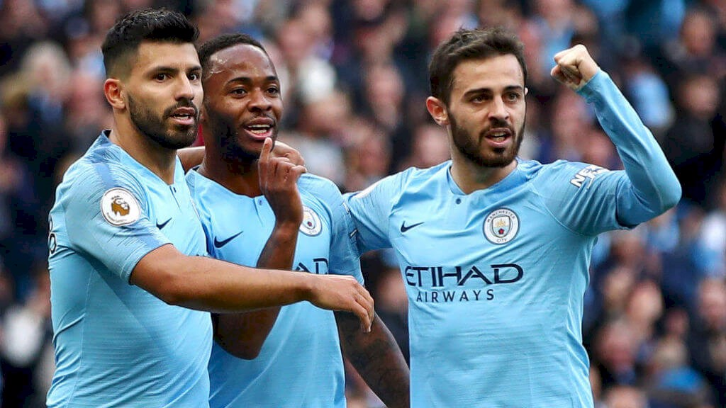 1-0 CITY: The boys celebrate Sterling's opener