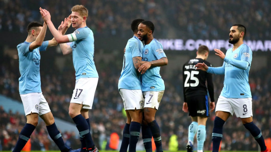 CELEBRATION TIME: The Blues are all smiles after Raheem Sterling's early strike