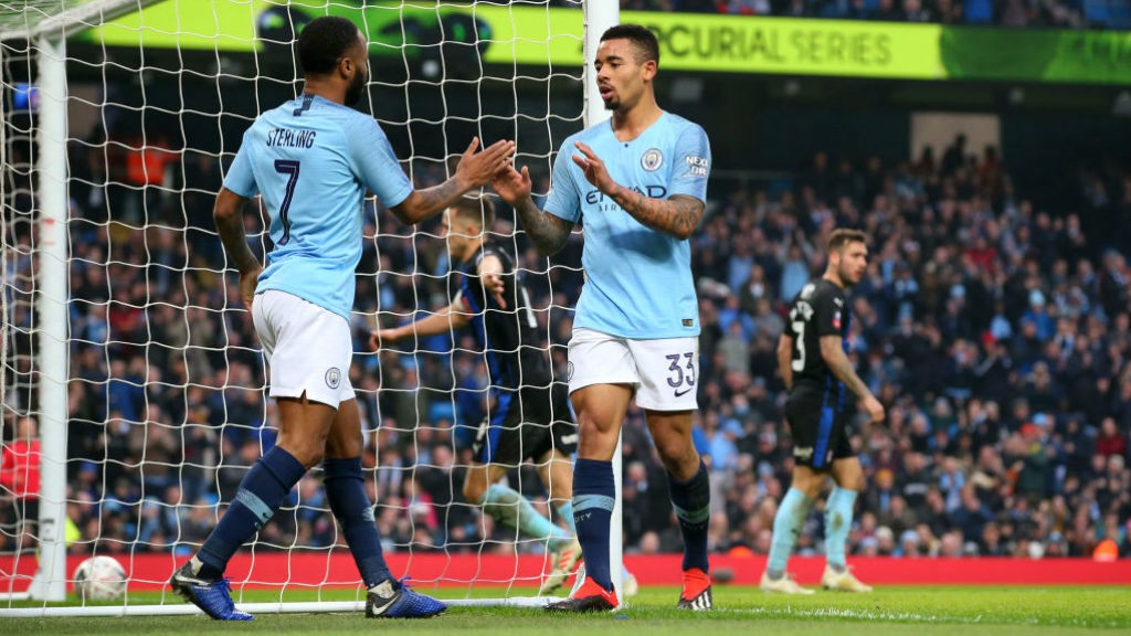 FOUR TOPS: Gabriel Jesus celebrates with Raheem Sterling after tapping home City's fourth goal