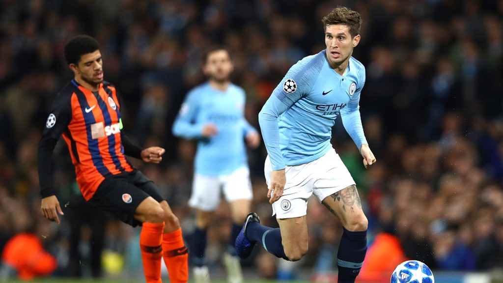 ROLLING STONES: City and England defender John Stones shepherd's the ball to safety