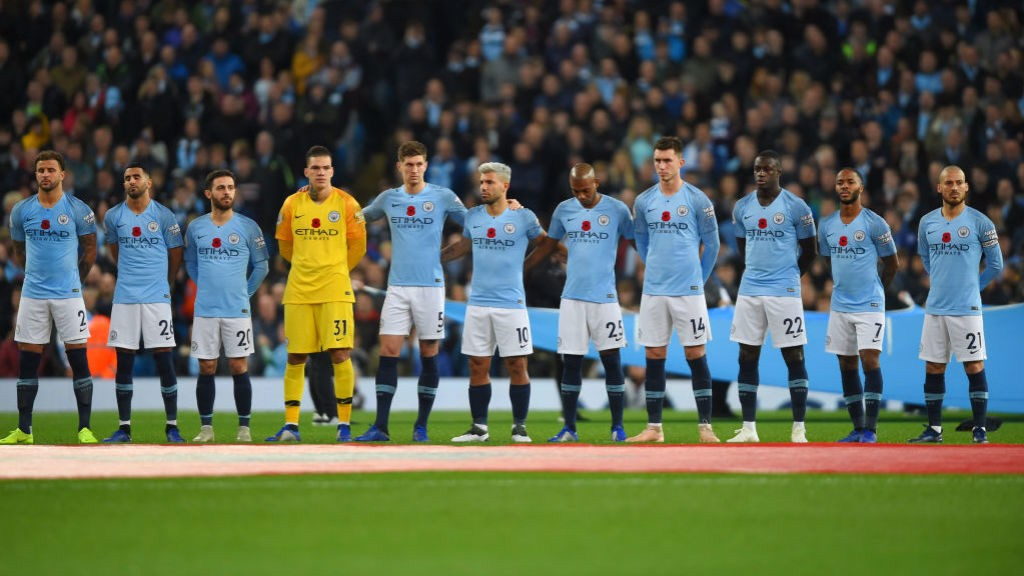 SOMBRE MOMENT: The players paused to commemorate the 100th anniversary of the Armistice