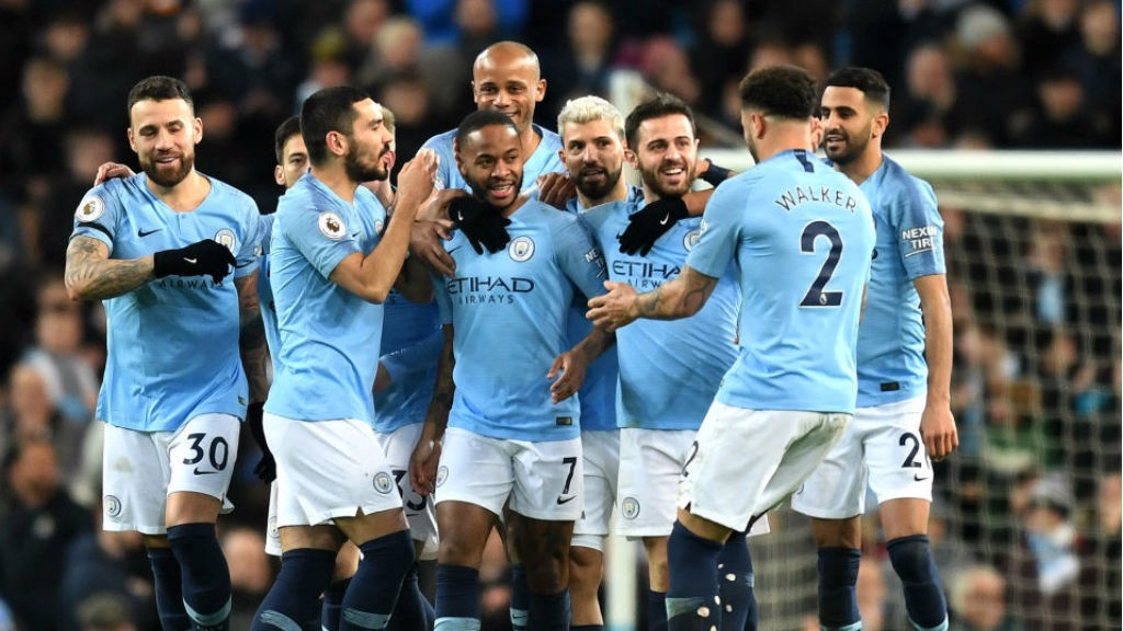 CENTRE OF ATTENTION: Raheem Sterling is mobbed after his crucial opener