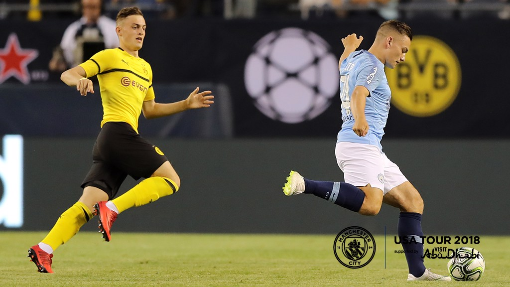 BOLTON ON THE BALL: Luke Bolton in action against Dortmund