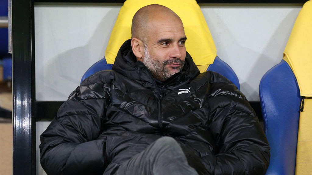 LEADING MAN: Pep Guardiola takes in the atmosphere at the Metalist Stadium ahead of kick-off
