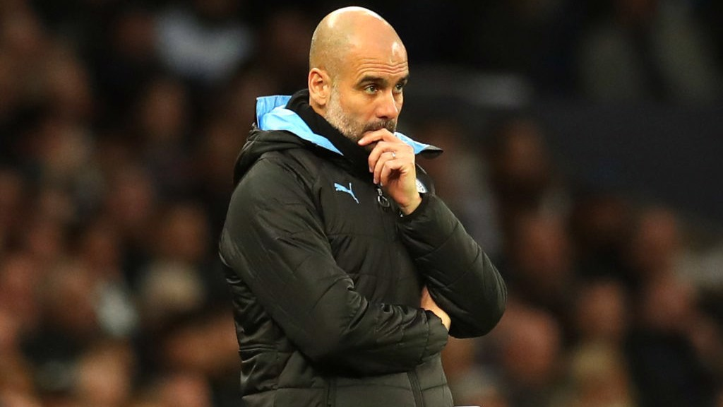 TACTICIAN: Guardiola watches on from the touchline in the first half.