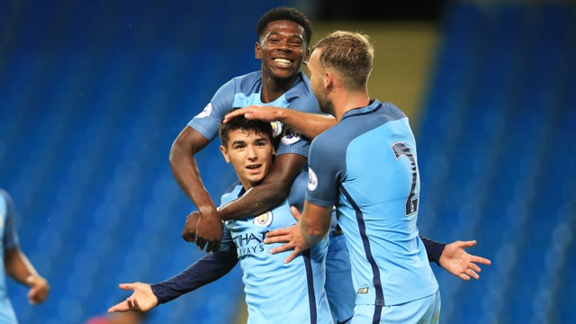 PICK THAT ONE OUT: Brahim is mobbed after his equaliser