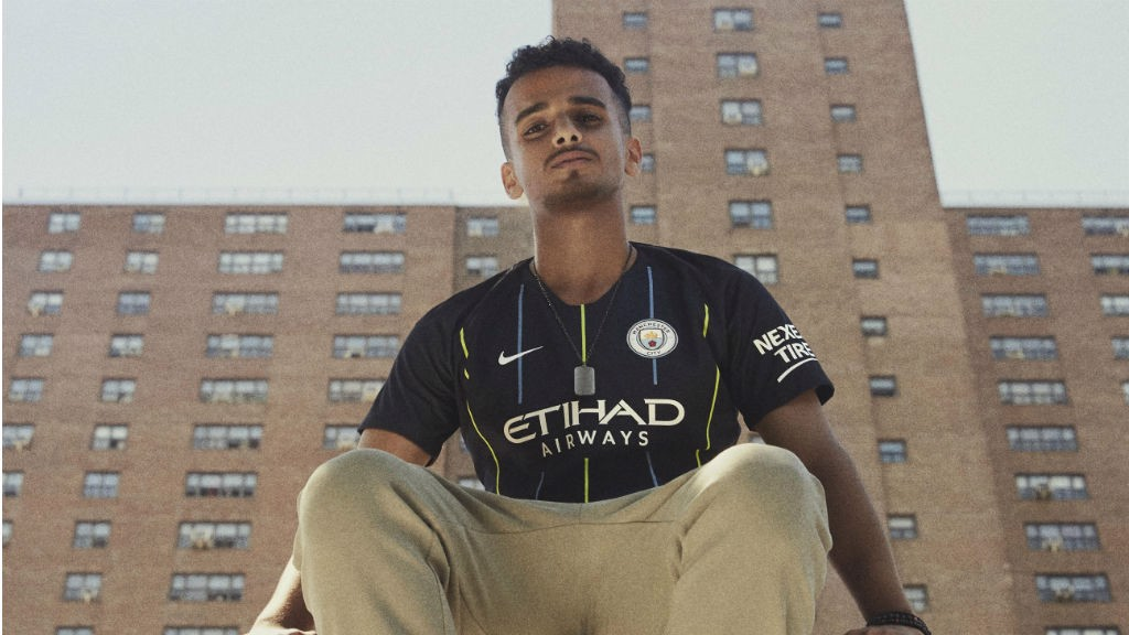 SHARP SHOOTER: Tahir, a participant in the original City in the Community programme in New York in 2010, models our new away shirt
