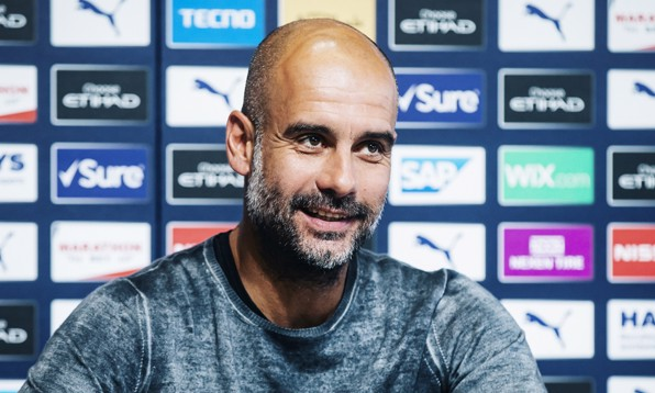 ALL SMILES: Pep Guardiola gives his thoughts ahead of City's game against Spurs on Saturday.