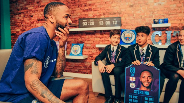 STERLING WORK: Raheem with some of the students from Ark Elvin Academy